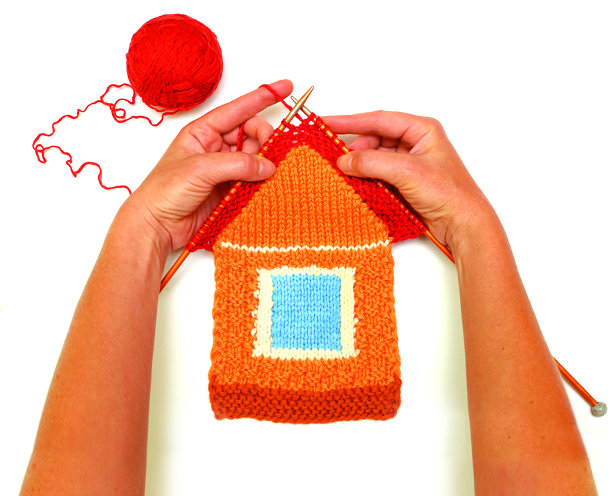 Knitted house on white background